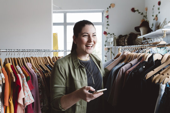 Small business owner using her mobile phone