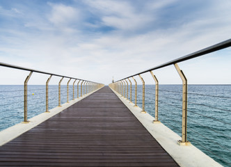 Endless pier leading to sea