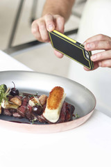 chef taking photo of his dish