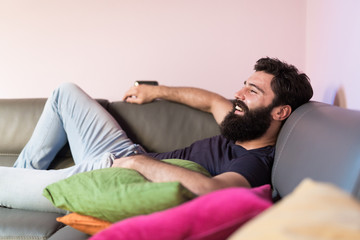 Bearded man relaxing on the sofa