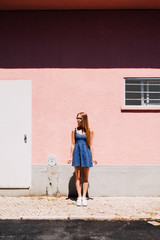 Woman Standing in front of the Pink House