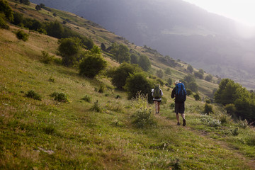 Backpackers in the morning going up the valley
