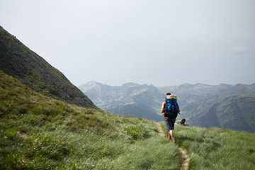 Young backpacker in a high trail of the Pyrenees