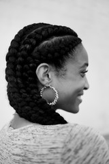 A young african american woman with braided hair