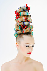 Girl with hair curlers on her head