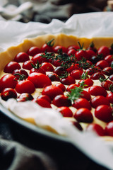 Vegan quiche with cherry tomatoes, tofu and thyme
