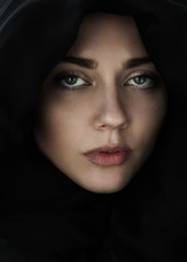 beautiful young girl in a hood closeup