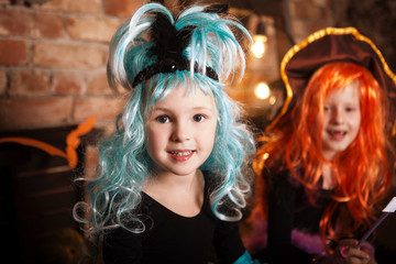 Halloween girl  Costumes of Witches looking at camera on holiday