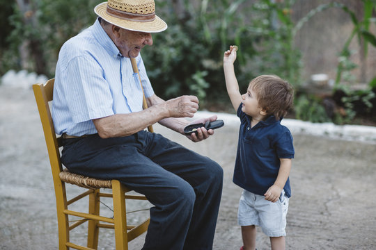 Grandfather giving money to his grandchild