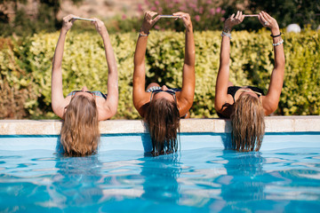 women enjoy in the pool
