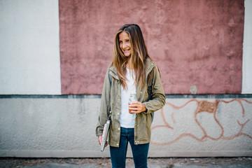 Young schoolgirl standing outdoor