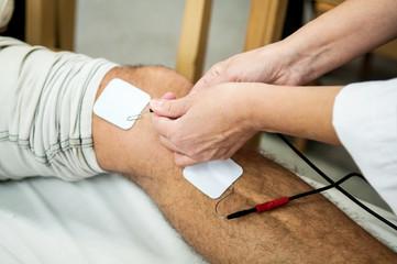 Doctor healing a knee's patient