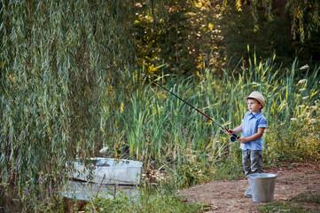 Little boy fishing.