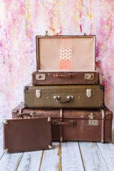 pyramid of several vintage suitcases