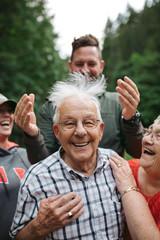 Joking grandkids mess up grandpa's hair