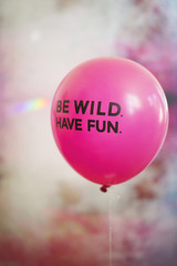 Words be wild, have fun on pink flying balloon