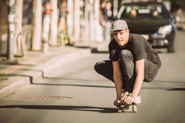 Skateboarder ride a skateboard slope through the city street