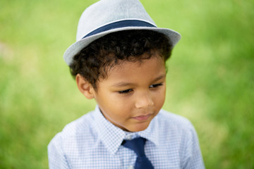 Cute Mixed Race Kid In A Hat