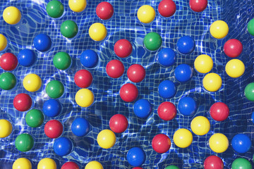 Color balls on a swimming pool