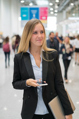 young beautiful businesswoman at a trade fair