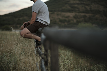 Man on rural fence