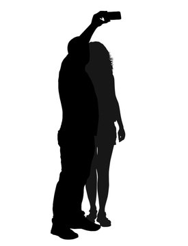 Couple silhouette taking selfie with smartphone