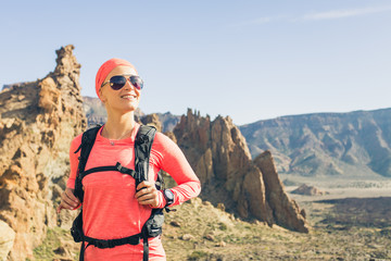 Happy girl hiker reached mountain top, backpacker adventure