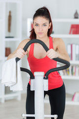 healthy young woman exercising at home