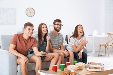Friends watching TV at home