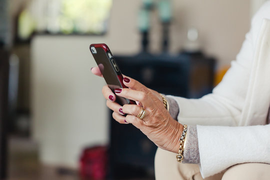 Older lady's hands holding a mobile phone
