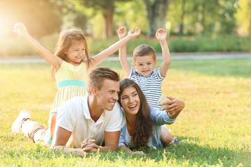 Happy family making selfie in park