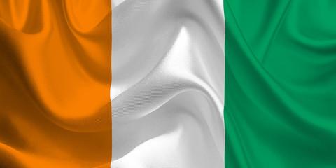 Waving flag of the Côte d'Ivoire. Ivory Coast Flag in the Wind. Ivory Coast National mark. Waving Côte d'Ivoire Flag. Ivory Coast Flag Flowing.