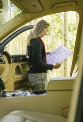 Woman Reading Map on Road Trip