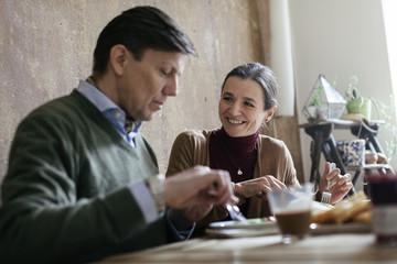 Mature Couple eating Breakfast