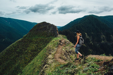Woman Hiker on Mountain Trail