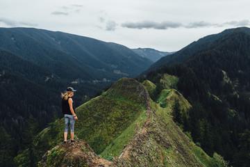 Woman Hiker Standing on Mountain Ridge