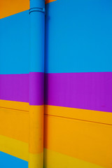 Blue Purple Yellow Orange at horizontal strip of wall background