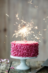 Pink celebration cake with sparkler