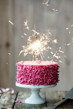 Pink celebration cake with sparkler
