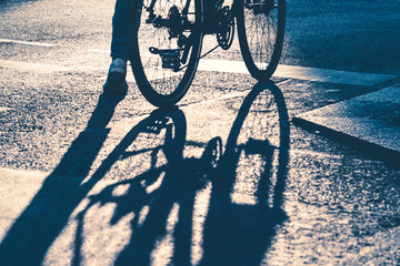 Bike and shadow on traffic stop line
