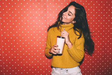 Young woman over a red polka dots wallpaper