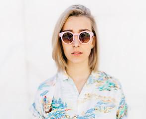 Portrait of blondie in pink sunglasses