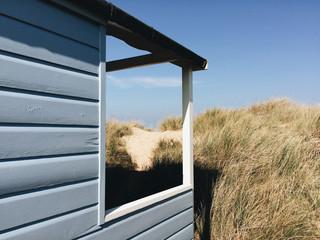 Beach huts among the sand dunes at Old Hunstanton, Norfolk, UK.