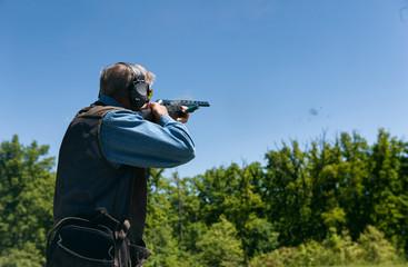 Shooting: Man Shoots Shotgun And Hits Clay Pigeon