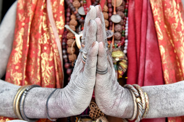 Detail of a sadhu's hands praying on a temple