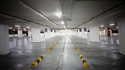 Indoor parking  in shopping center with copy space. The parking lot has enough light so it is safe.car park.