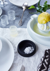 Fresh squeezed lemon juice with salt and dinnerware