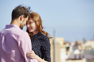 Loving Woman With Man Embracing In City