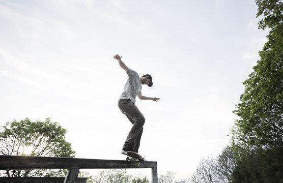 Skateboarder practising skills.
