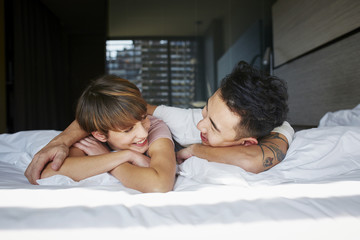Romantic Couple Lying In Bed